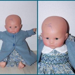 Manteau de poupée